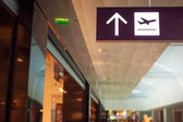 Photo Sign in terminal with an arrow