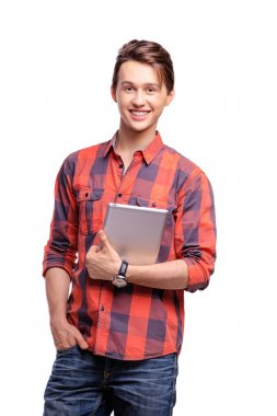 Youth and technology. Studio portrait of handsome young man holding tablet computer. Isolated on white. stock vector