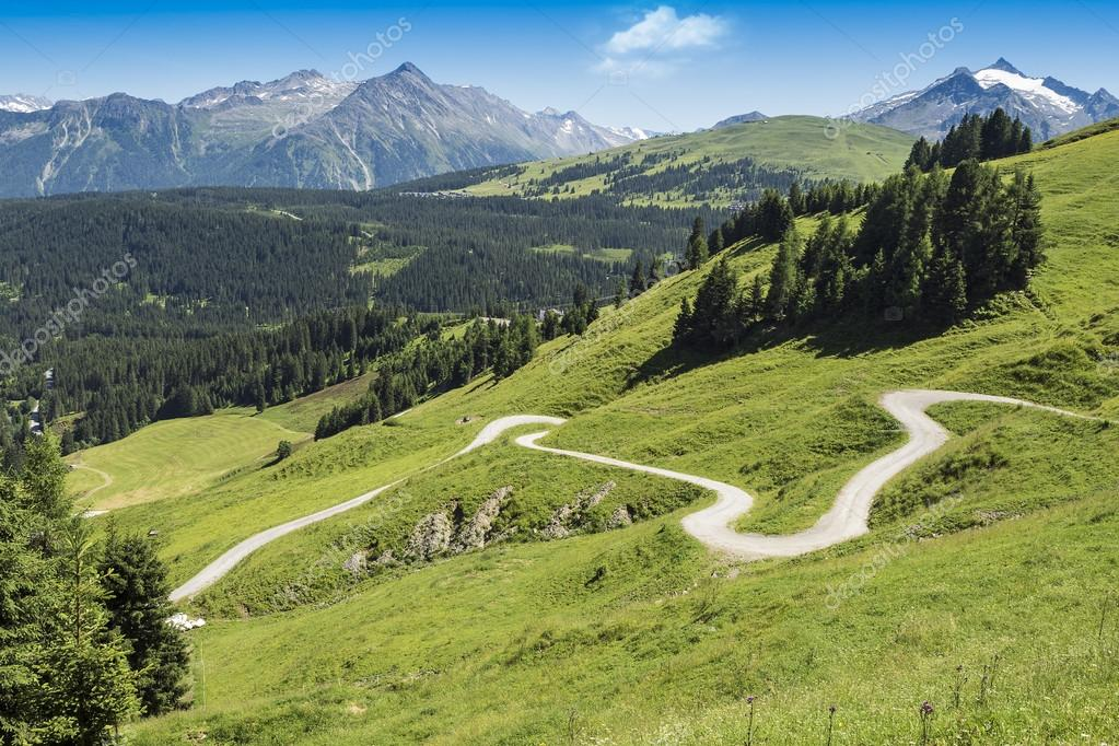 Winding hiking path in Alps, Austria