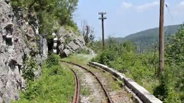 Timelapse with back view of an old mountain railroad