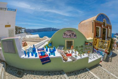 OIA, SANTORINI, GREECE - JUNE 21, 2021: Shop with typical souvenirs from Greece and Santorini island, located on Main Street Nik. Nomikou.