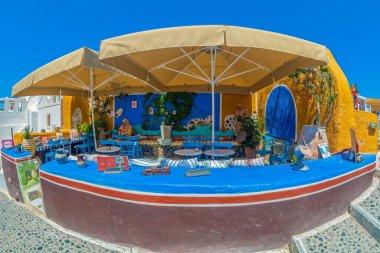 OIA, SANTORINI, GREECE - JUNE 21, 2021: Turkish open-air cafe, located on Main Street Nik. Nomikou.