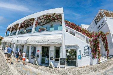 FIRA (Thera), SANTORINI, GREECE - JUNE 21, 2021: Nice restaurant with local wines and cofee located in main Street Ipapantis.