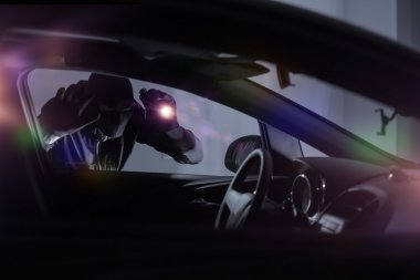 Car Robber with Flashlight