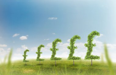 Financial growth and success on a green summer natural green grass landscape with a single trees in the shape of a money sign showing a business concept of growing prosperity and investments