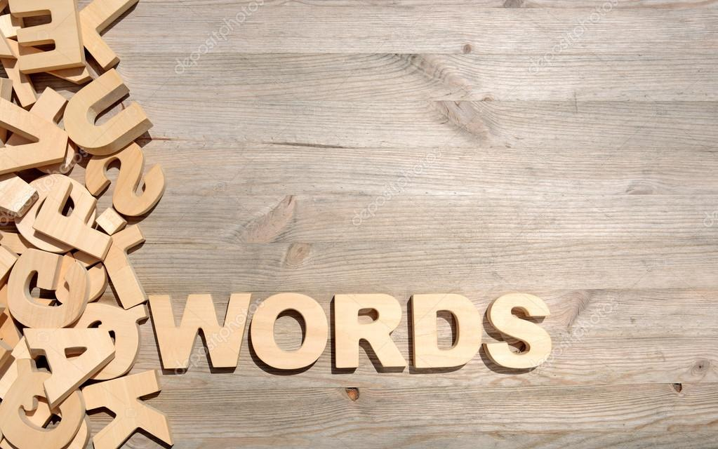 word words made with block wooden letters next to a pile of other