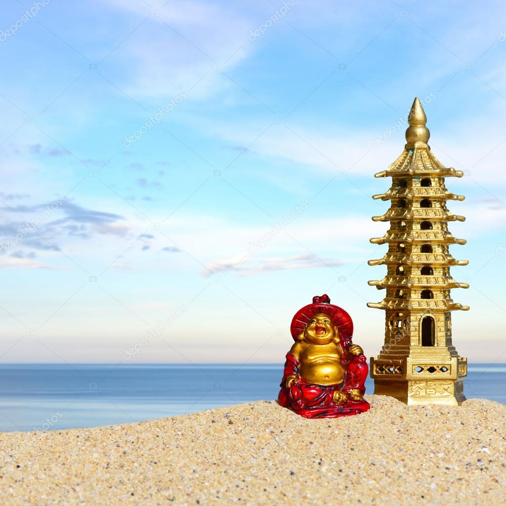 Laughing Buddha And Seven Storied Pagoda In The Sand Symbol Of Good