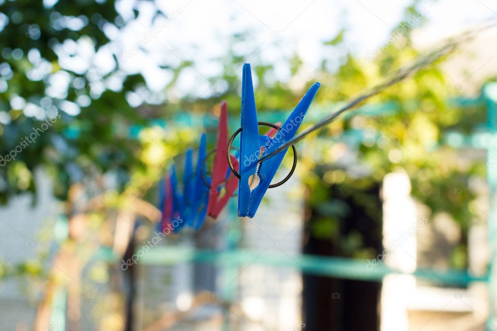 Clothespins on a wire in the yard
