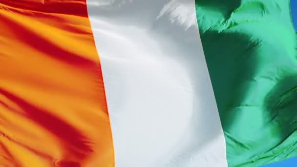 Cote Ivoire flag in slow motion seamlessly looped with alpha