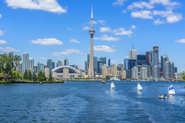 Toronto's skyline with CN Tower over lake