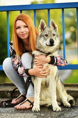 woman with czechoslovak wolfdog