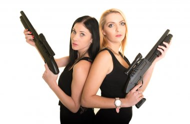 Two beautiful women with guns