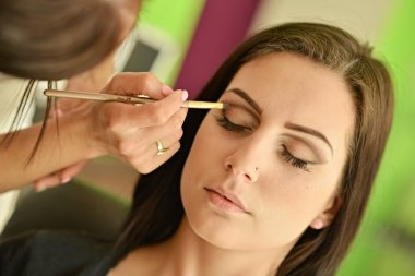 Make-up artist doing make up