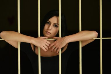 Woman behind the bars