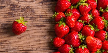 Fresh red strawberry on wood background