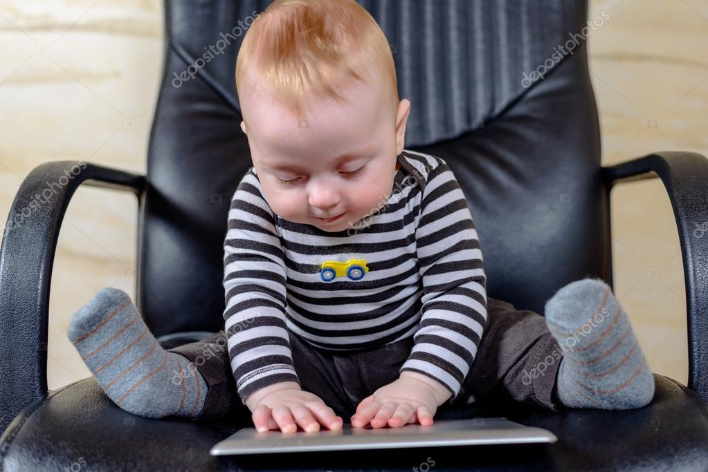 Wondrous Cute Baby Boy With Tablet Sitting On Office Chair Stock Interior Design Ideas Apansoteloinfo