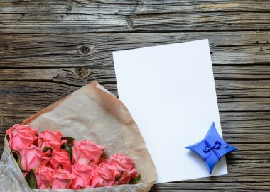 Bag of roses with blank paper and gift box