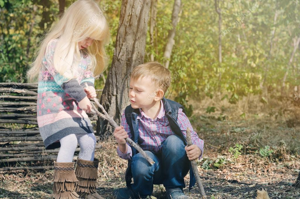 White Little Kids Fighting for Dried Stick