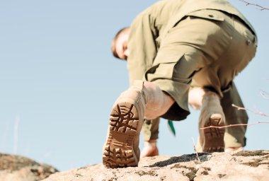 Shoe Sole of a Boy Scout Climbing a Rock