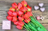 Fotografie Bouquet of fresh tulips with a gift