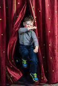 Photo Boy Clown Jumping Through Stage Curtains
