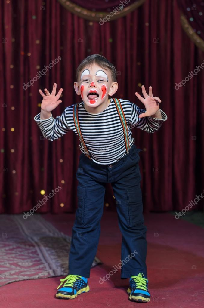 Boy Dressed as Clown Acting Silly on Stage