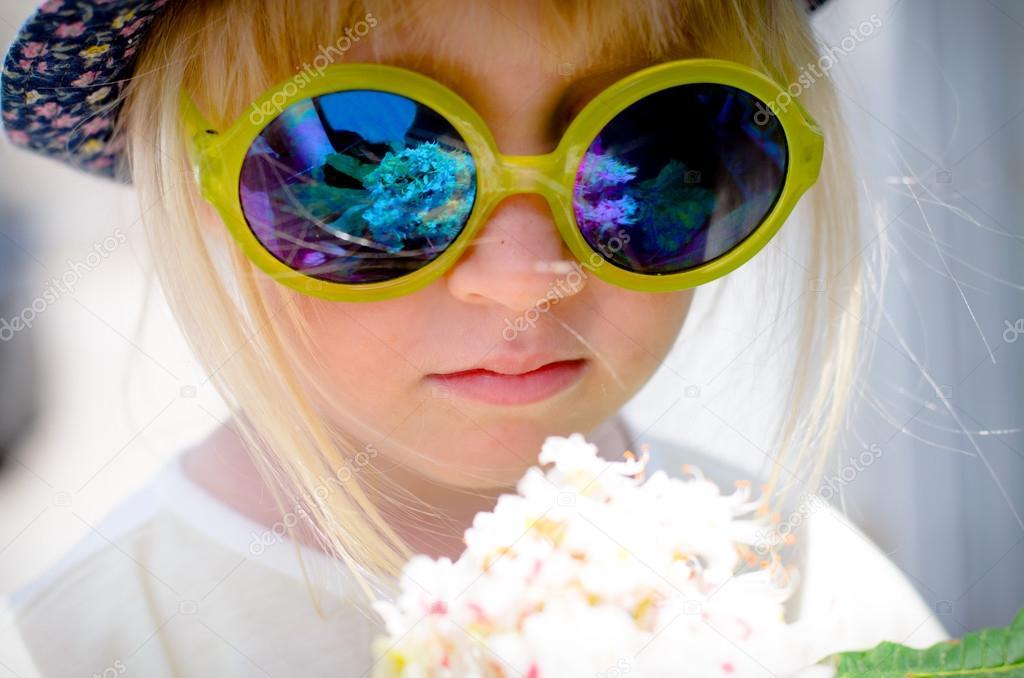 Cute little girl wearing mirrored round sunglasses