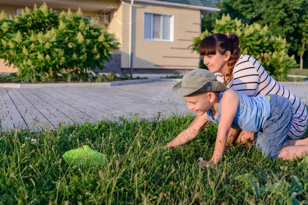 Mother and Son with Bug Net Exploring on Lawn