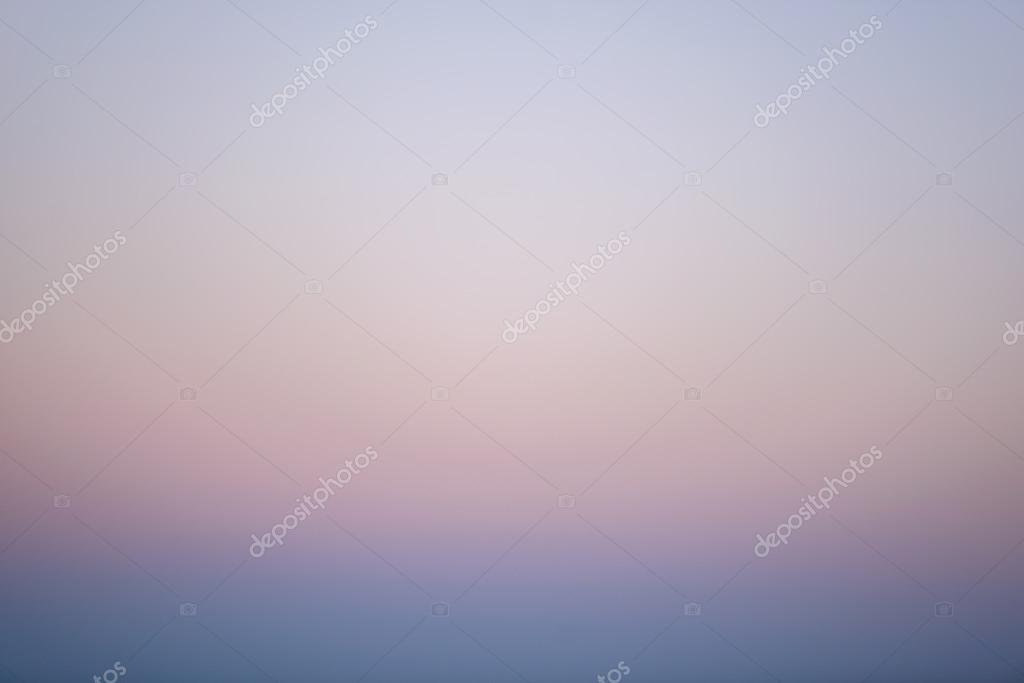 Faded blues and pinks of a sky at sunset
