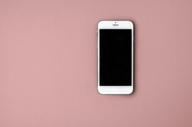 Blank smart phone on pink background