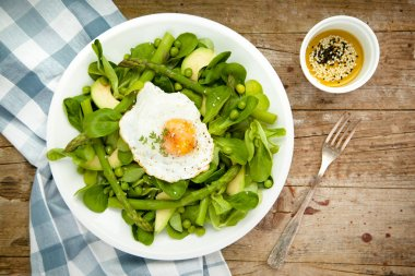 Healthy spring green salad with egg