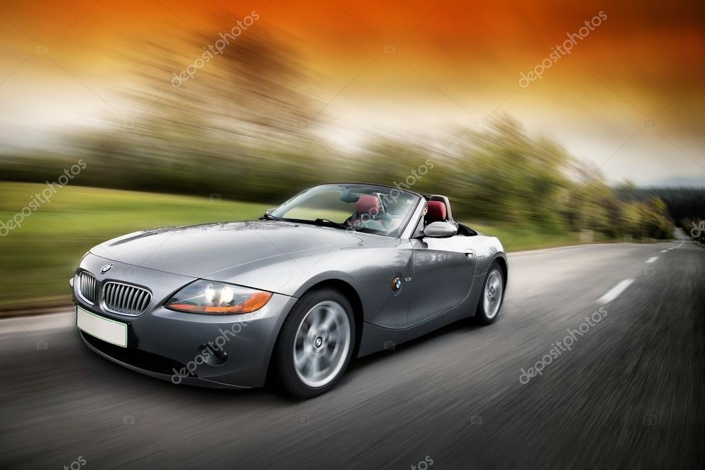 Man driving BMW Z4 fast on the karst road