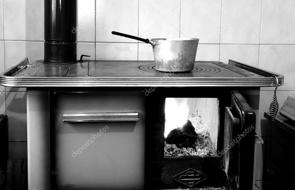 Old Wood Burning Stove In The Kitchen Of Ancient Home Stock Photo