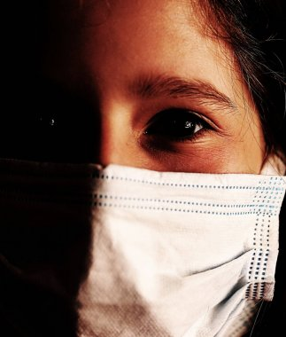 young girl with surgical mask with a very dramatic effect