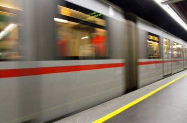 fast underground subway train while hurtling fast