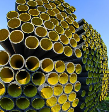 wallpapers of yellow corrugated pipes in a roadworks for optical