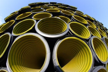 yellow corrugated tube photographed with fisheye lens