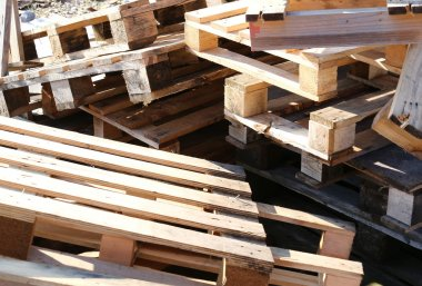 pile of wooden pallets piled in a landfill