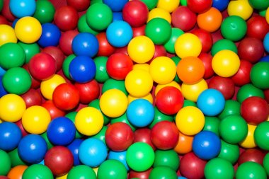lots of colorful plastic balls in the pool for children