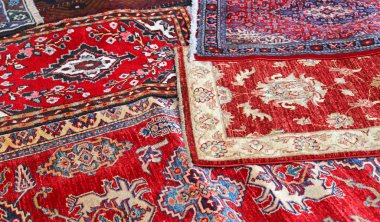 Asian rugs for sale in the shop of fabrics and textiles