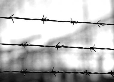 old lines of barbed wire to demarcate the border