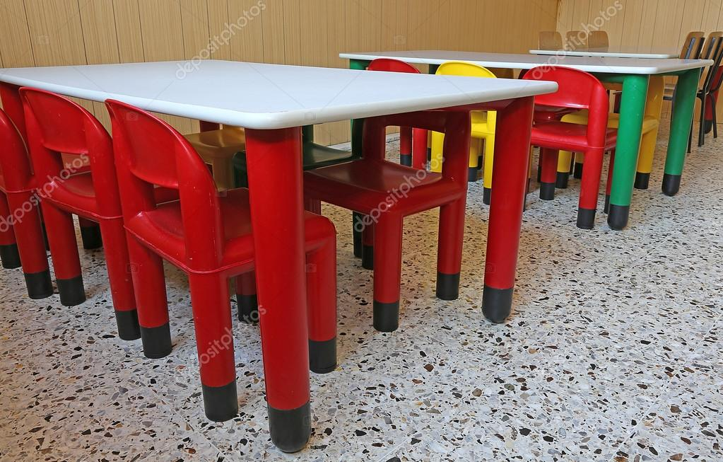 plastic chairs and small tables in the nursery class stock photo