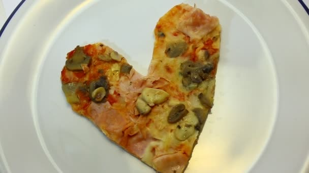 Heart-shaped pizza with  mushrooms and ham