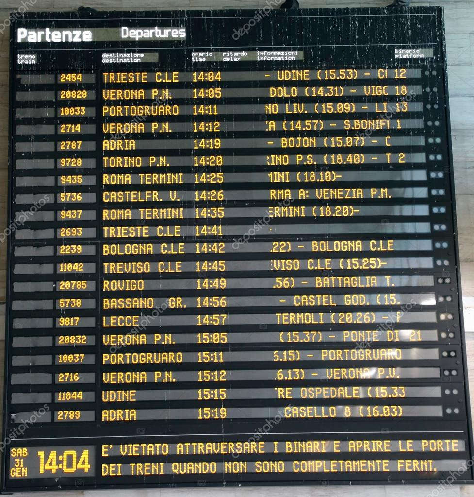 train schedule Board at a station in Italy — Stock Photo