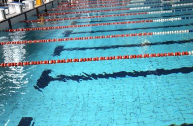 pool with blue water and the swimming lanes