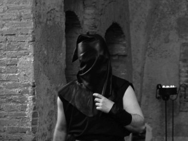 executioner with black hood on his head in the castle