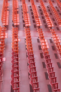 empty chairs of iron before the musical concert