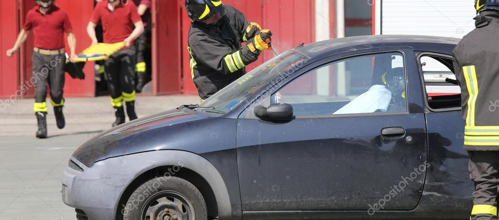 firefighters during a practice of traffic accident simulation ...