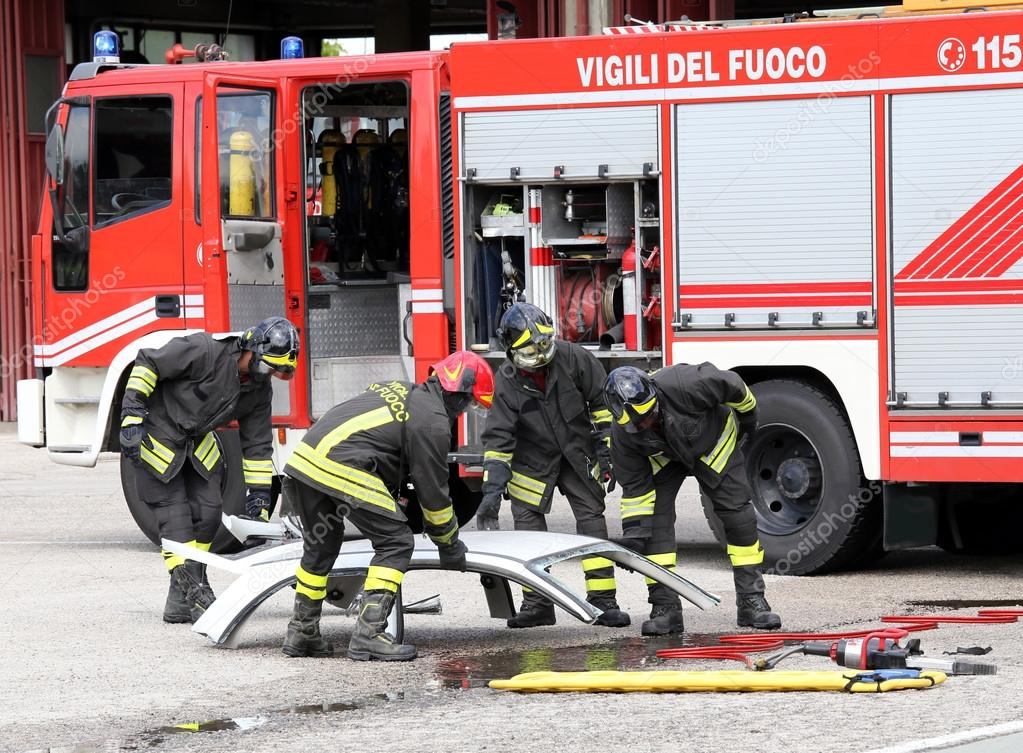 road accident with car parts and the firetruck