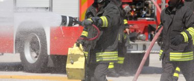 firemen with the fire extinguisher during a practice session at
